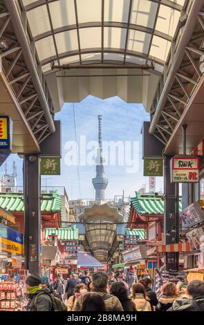 tokyo, japan - january 28 2020: Tourists walking in the nearby Shin-Nakamise covered arcade shopping streets of Sensoji temple in Asakusa with Tokyo S - Stock Photo