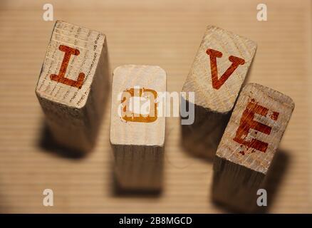 Love word on wooden blocks. Love romance devotion concept - Stock Photo