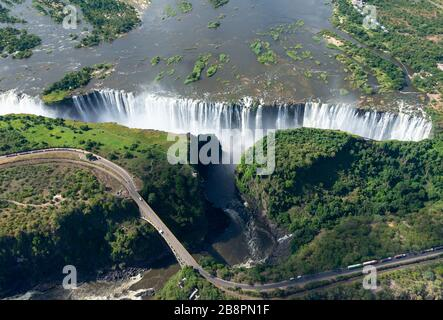 Aerial view of Victoria Falls located between Zimbabwe and Zambia in Africa. Seven Natural Wonders of the World. Zambezi River and border bridge.