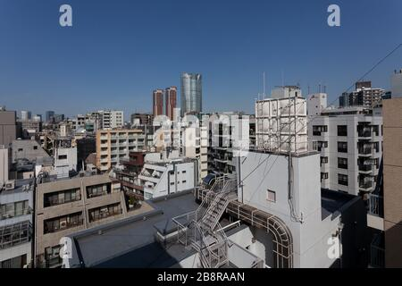 Roppongi Hills tower seen from a rooftop in Azabu Juban, Tokyo, Japan. Saturday March 21st 2020 - Stock Photo