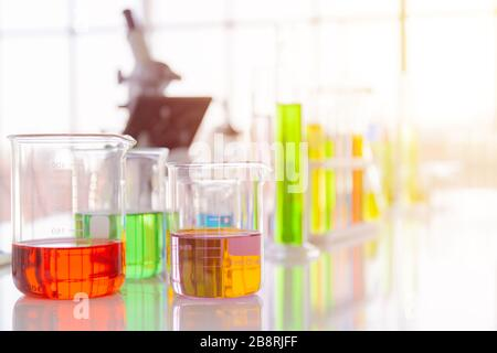 Chemical reagent bottles in scientific experiment bottles of different shapes and sizes - Stock Photo