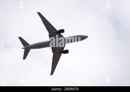 Low angle view of Commercial airplane in mid flight; - Stock Photo