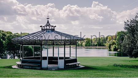 Beautiful Victorian bandstand in Roundhay public park city of Leeds, Yorkshire with Waterloo lake background - Stock Photo