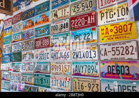 SELIGMAN, AZ - JUNE 29, 2018: Old car plates lined on a wall. Seligman is a famous city along historic Route 66. - Stock Photo