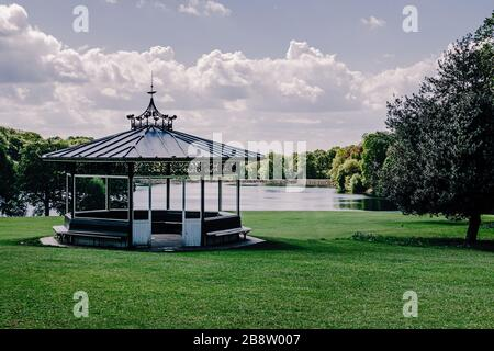 Beautiful Victorian bandstand and Waterloo lake in public Roundhay park  Leeds, Yorkshire England UK - Stock Photo