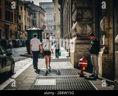 Rome, Italy - Oct 7, 2018. People walking on street in downtown. Rome, the Eternal City, is the capital and largest city of Italy. - Stock Photo