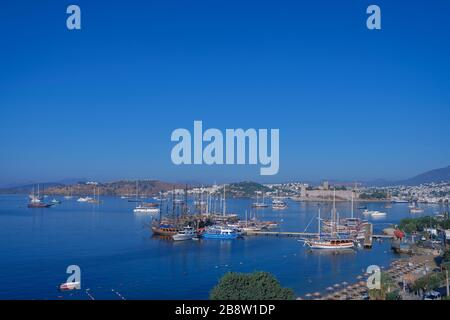 Bodrum Downtown with castle, beach and marina. View of Bodrum Beach, traditional white houses, boats, yachts in Bodrum town Turkey. - Stock Photo
