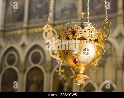 Gold olive lamp used in orthodox church.