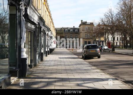 Cheltenham, UK. 23 March 2020. One of the spa town of Cheltenham in Gloucestershire busiest and exclusive shopping streets, Montpellier Walk. almost completely deserted on Monday due to the Coronavirus/Covid-19 pandemic.  Credit: Thousand Word Media Ltd/Alamy Live News - Stock Photo