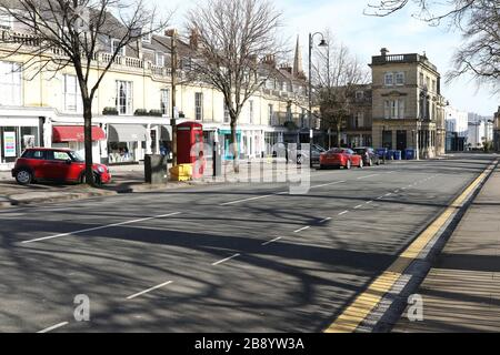 Cheltenham, UK. 23 March 2020. One of the spa town of Cheltenham in Gloucestershire busiest and exclusive shopping streets, Montpellier Walk. almost completely deserted on Monday due to the Coronavirus/Covid-19 pandemic.  Credit: Thousand Word Media Ltd/Alamy Live News