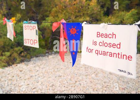 warning no entry sign at beach due to coronavirus epidemic quarantine