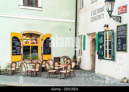 Rustic cafe in old town of Prague in spring with painted walls - Stock Photo