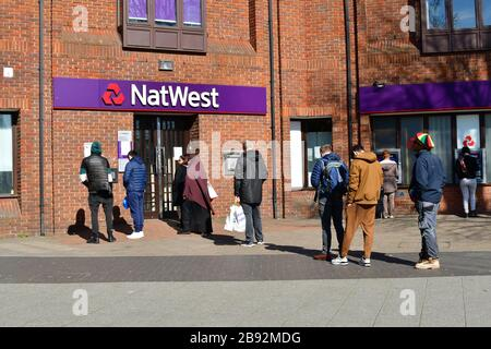 London, UK. 23 Mar, 2020. Coronavirus threat - People queue outside NatWest Bank only allow one at a time to entry bank, on 23 March in Walthamstow, London, UK. Credit: Picture Capital/Alamy Live News - Stock Photo