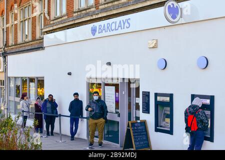 London, UK. 23 Mar, 2020. Coronavirus threat - People queue outside Barclays Bank only allow one at a time to entry bank, on 23 March in Walthamstow, London, UK. Credit: Picture Capital/Alamy Live News - Stock Photo