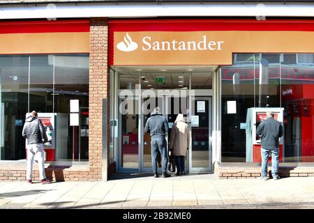 London, UK. 23 Mar, 2020. Coronavirus threat - People queue outside Santander Bank only allow one at a time to entry bank, on 23 March in Walthamstow, London, UK. Credit: Picture Capital/Alamy Live News - Stock Photo