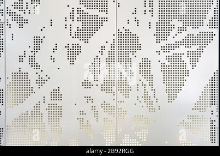 White Perforated Metal Panel with an Abstract Square Pattern. Architecture Facade Cladding Using Parametric Design and Lighting from Behind. - Stock Photo