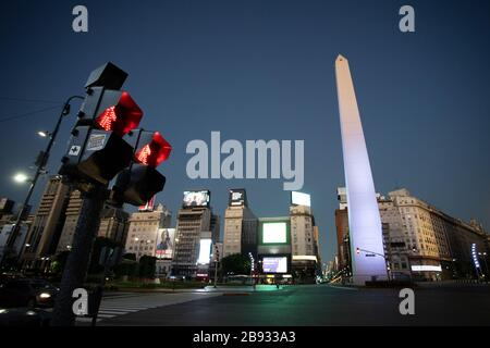 Buenos Aires, Argentina - March 23, 2020: Commute red light and Buenos Aires Downtown view at night on a city in Quarantine in Buenos Aires, Argentia - Stock Photo