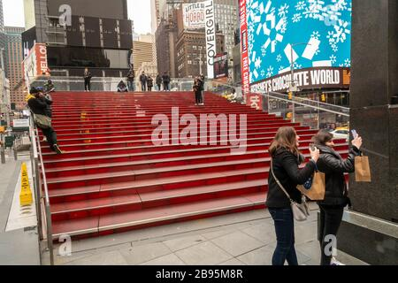 Red steps in empty Times Square in New York on Thursday, March 19, 2020 due to COVID-19. (© Richard B. Levine) - Stock Photo