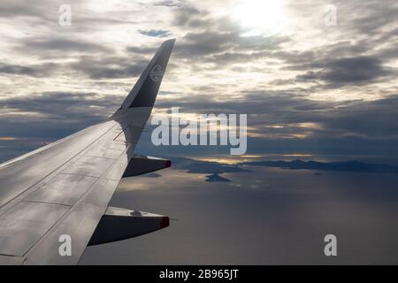 Air New Zealand plane flying over New Zealand - Stock Photo
