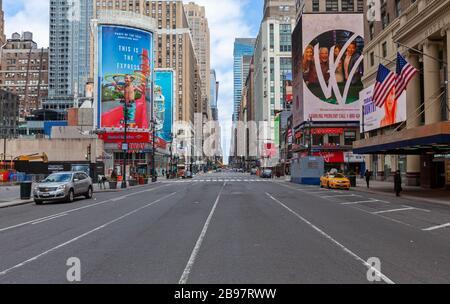 Few automobiles travel on the empty streets in New York City because of COVID-19, Coronavirus.