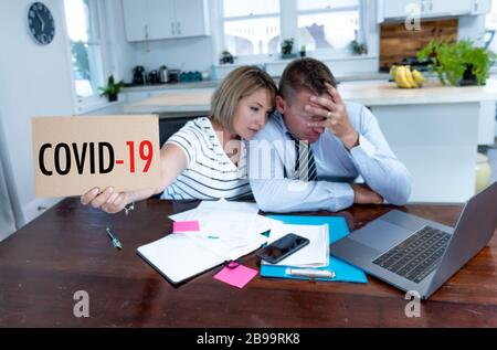 Coronavirus economic recession. Family couple in distress of job losses worried about bills, credit debts, loans and home finances. Impact of COVID-19