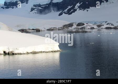 The abandoned British base at Port Lockroy,  now a museum and post office, on the north-western shore of Wiencke Island, Palmer Archipelago, Antarctic - Stock Photo