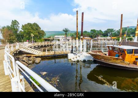 Ein Gev, Israel - March 16, 2020: View of the fishing port of Kibbutz Ein Gev, on the east shore of the Sea of Galilee (Kinneret lake), with visitors - Stock Photo