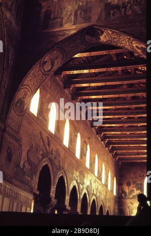 View from the choir into the nave of the richly decorated cathedral of Monreale. [automated translation] - Stock Photo