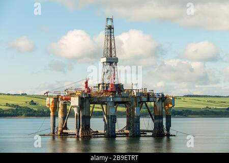 Ocean Nomad (1975), an offshore oil jackup drilling platform, lies decommissioned in the Cromarty Firth, Scotland, UK, 2016. - Stock Photo