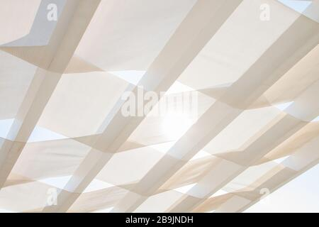 White Transparent Curtains and Shade Sail in El Gouna Egypt - Stock Photo