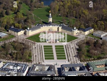 24 March 2020, Baden-Wuerttemberg, Karlsruhe: The Schlossplatz and the park are empty in bright sunshine. Photo: Uli Deck/dpa - Stock Photo