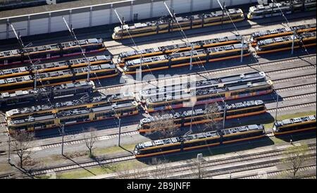 24 March 2020, Baden-Wuerttemberg, Karlsruhe: Trams are located in a depot of the transport companies (aerial photo). Photo: Uli Deck/dpa - Stock Photo