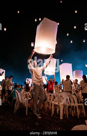 Chiang Mai Thailand November 2018, tourist and local people release white lantern in the sky for the Loi Krathong or Yee Peng festival - Stock Photo