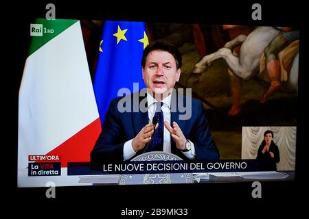 Turin, Italy. 24th Mar, 2020. TURIN, ITALY - March 24, 2020: The Rai 1 TV channel broadcasts the video press conference of the Italian premier Giuseppe Conte while announcing new measures for the coronavirsu emergency. The Italian government imposed unprecedented restrictions to halt the spread of COVID-19 coronavirus outbreak, among other measures people movements are allowed only for work, for buying essential goods and for health reasons. (Photo by Nicolò Campo/Sipa USA) Credit: Sipa USA/Alamy Live News - Stock Photo