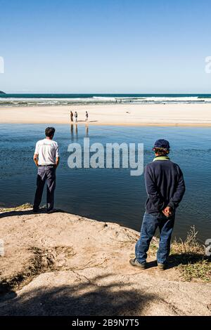 Fishermen at Guarda do Embau Beach. Palhoca, Santa Catarina, Brazil. - Stock Photo