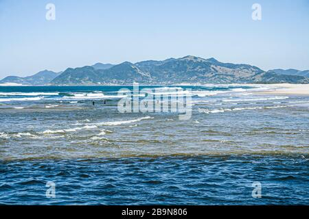Guarda do Embau Beach and Tabuleiro Mountains in the background. Palhoca, Santa Catarina, Brazil. - Stock Photo