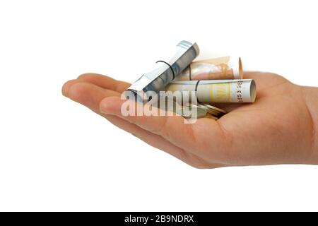 Turkish liras, banknote and coins in the palm - Stock Photo