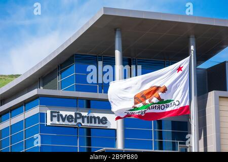 Five Prime Therapeutics logo at the biopharmaceutical company headquarters in Silicon Valley. Flag of California proudly waving in the wind - South Sa - Stock Photo