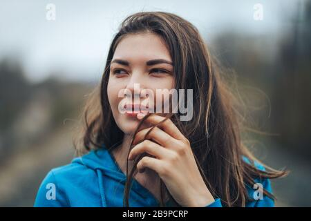 close up Portrait of beautiful mixed race Caucasian young woman with dark eyes and hair - Stock Photo