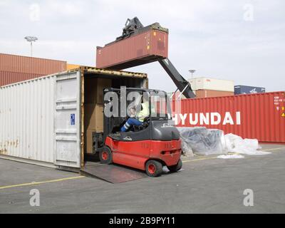 Container stuffing at Container Packing Center, Tollerort in the Port of Hamburg, Germany. - Stock Photo