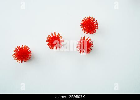 Abstract virus strain model of MERS-Cov or middle East respiratory syndrome coronavirus and Novel coronavirus 2019-nCoV on gray background. Flat lay. - Stock Photo