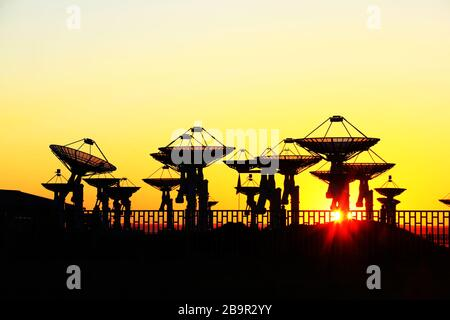 The observatory's radio telescope in the morning, the silhouette of the radio telescope - Stock Photo