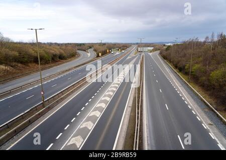 Edinburgh, Scotland, UK. 25 March, 2020. Day two of the Government enforced lockdown in the UK. All shops and restaurants and most workplaces remain closed. Cities are very quiet with vast majority of population staying indoors. Pictured; View of virtually deserted Edinburgh Bypass highway at Hermiston in Edinburgh.  Photo taken at what would be morning rush hour with heavy congestion. Iain Masterton/Alamy Live News - Stock Photo