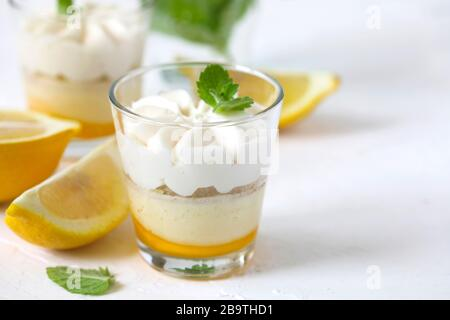 Limoncello - italian Dessert.  Lemon Cheesecake Mousse with Whipped Cream in cups. Summer dessert. - Stock Photo
