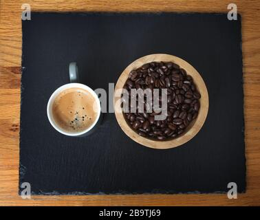 Sumatra Mandeling coffee beans and a cup of fresh coffee