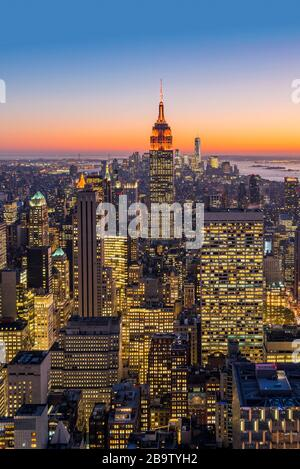 Midtown Manhattan skyline with Empire State Building at dusk, New York, USA