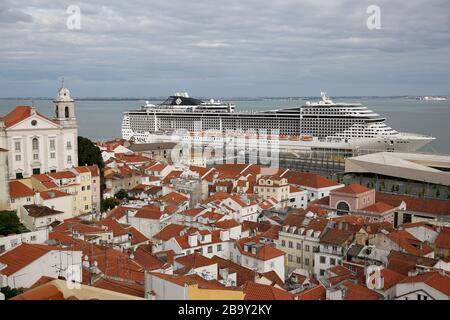 Lisbon. 24th Mar, 2020. The MSC Fantasia cruise ship is seen at the port in Lisbon, Portugal on March 24, 2020. The Portuguese authorities said on Sunday that all the passengers who arrived in Lisbon aboard a cruise ship will have to undergo screening tests for the COVID-19, Lusa News Agency reported. According to a statement from the Ministry of Internal Administration (MAI), the cruise ship MSC Fantasia from Brazil arrived in Lisbon early on Sunday with 1,338 passengers, of which 27 are Portuguese citizens. Credit: Pedro Fiuza/Xinhua/Alamy Live News - Stock Photo