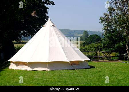 Bell tent in a garden on a summer day. - Stock Photo