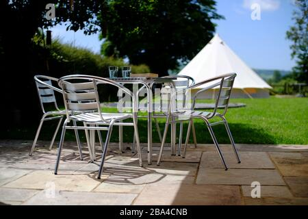 Glamping at home for a stay-cation. Garden camping in a bell tent for summer. UK - Stock Photo