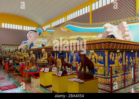 The large Reclining Buddha of Wat Chayamangkalaram a Thai Buddhist temple in George Town, Penang, Malaysia. - Stock Photo